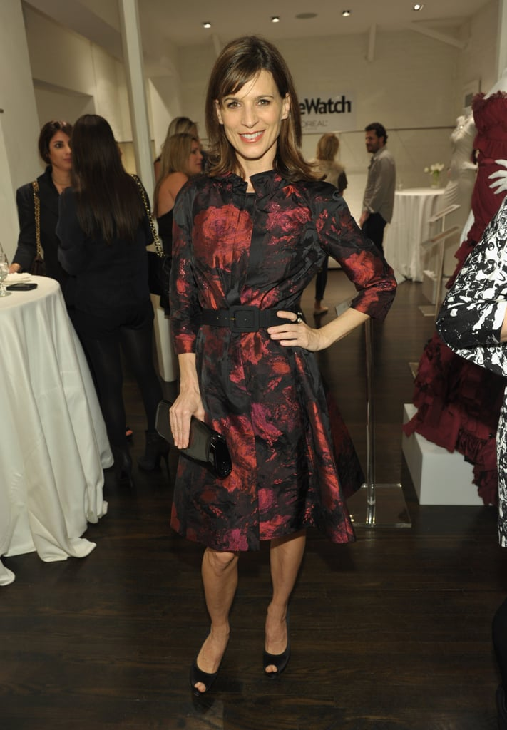 Perrey Reeves opted for a more sophisticated party approach in St. John's couture wildberry coat.