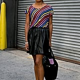 Nothing brightens up black leather faster than a rainbow-striped top.