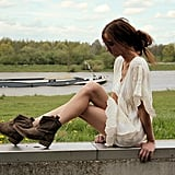 While your white dress channels easy, breezy glamour, edge up your outfit with flat ankle boots. Photo courtesy of Lookbook.nu
