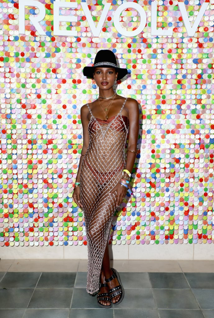 Jasmine Tookes wore a lovewave bikini with a sheer dress by Lovers & Friends at #REVOLVEfestival.