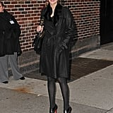 Jennifer Lawrence stood outside David Letterman's studio in NYC wearing a fur-lined leather trench coat with black tights and Christian Louboutin ankle boots.