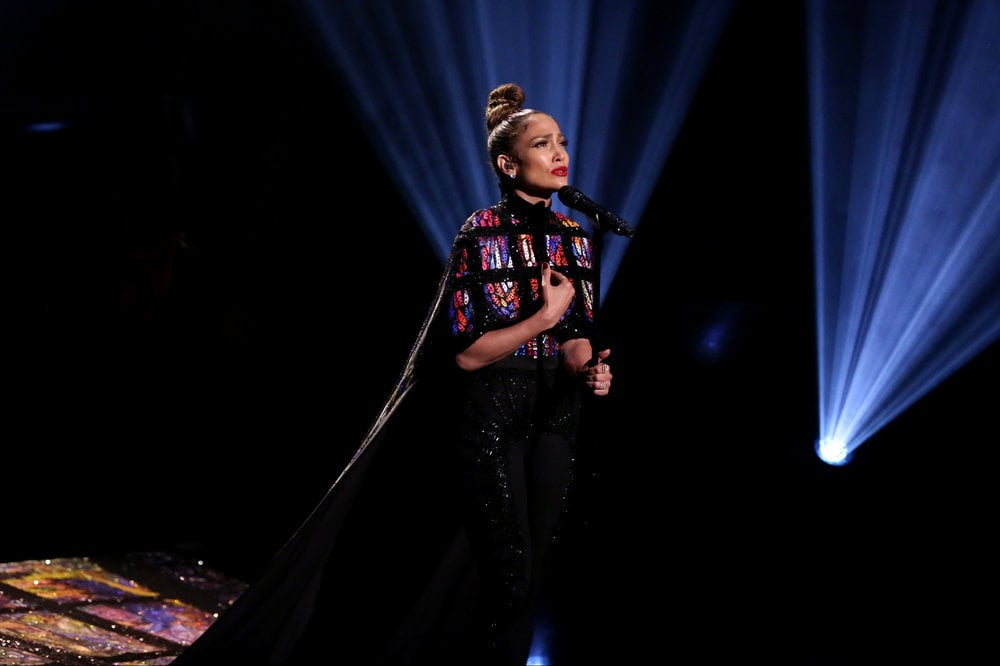 "Jennifer Lopez knows how to make a style statement, and last night on The Tonight Show Starring Jimmy Fallon, the singer left a powerful impression. For her and Lin-Manuel Miranda's performance of ""Love Make the World Go Round,"" the singer chose a printed Michael Cinco cape that evokes the stained glass of a church window and wore crystalized Death by Dolls leggings. As she sang, the colorful panels were illuminated in the darkness of the stage. It added an emotional element to the duo's song, which they recorded as a tribute to the victims of the Orlando nightclub mass shooting.  In the middle of the performance, Jennifer took off her cape, revealing a bustier underneath, but it was her voice that brought the loudest applause of all. It's hard to keep your emotions in check as you watch her sing. Ahead, see the beautiful 20-foot cape, which had 10,000 Swarovski crystals on it, and then check out another look she wore during her Today show appearance."