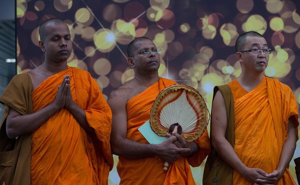 As hope waned among passengers' families on Sunday, Buddhist monks prayed at the Kuala Lumpur International Airport in Sepang, Malaysia.