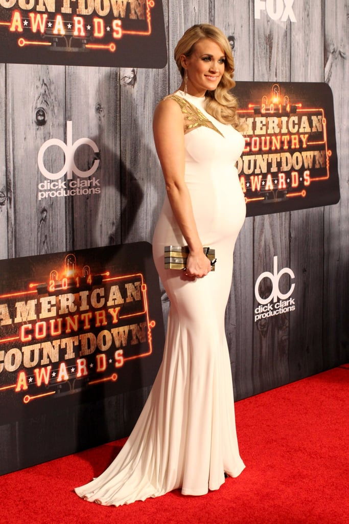 Carrie Underwood Shows Off Her Bump In White On The Red