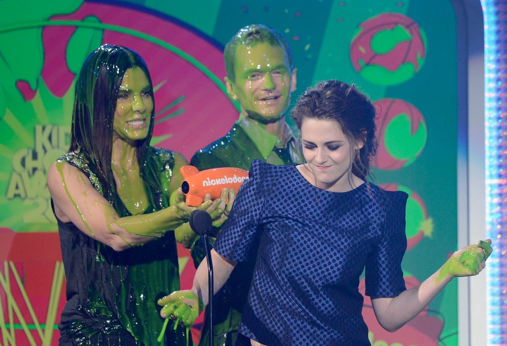 Kristen Stewart got slimed while accepting her Nickelodeon honor from Neil Patrick Harris and Sandra Bullock.