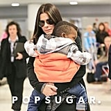 Sandra Bullock Lands in NYC With Little Louis