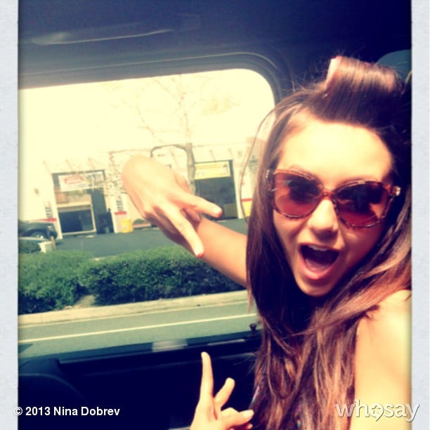 Nina Dobrev took her hairstyle on the road with some on-the-go rollers. Source: Instagram user ninadobrev