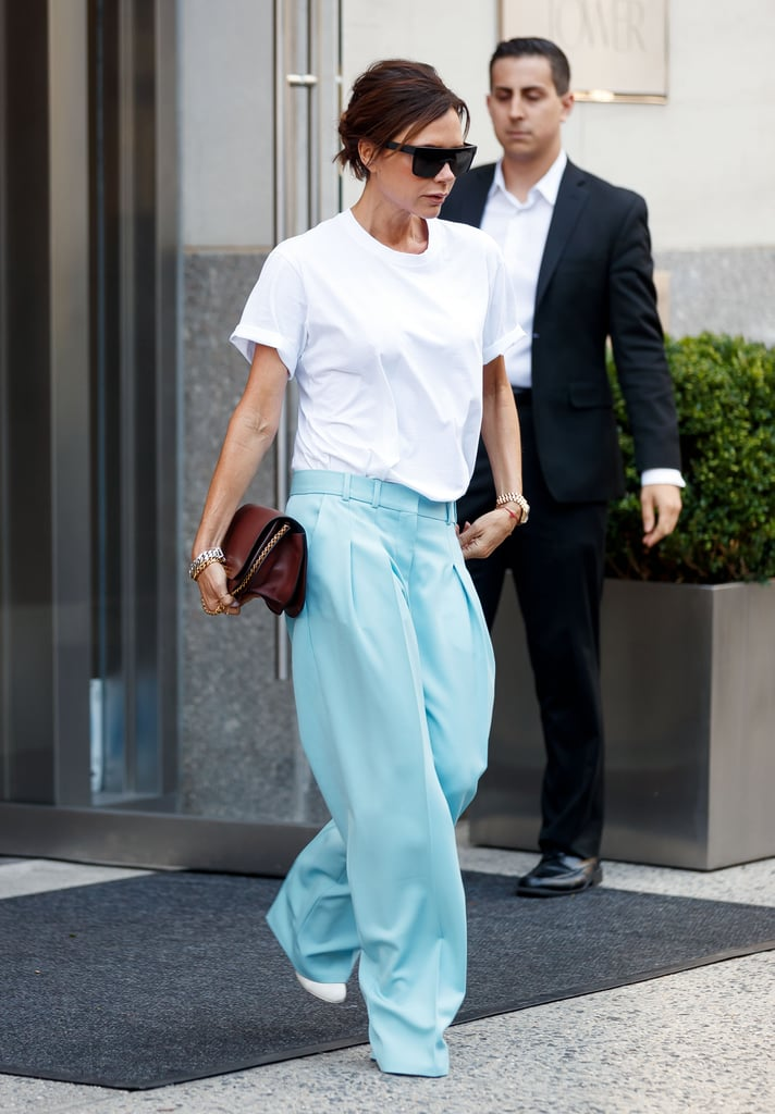 While we would like to live in our jeans and tee forever, that's not how Victoria Beckham rolls. As she exited a building in New York City, she showed off her more polished take on our favorite uniform. The star wore a loose-fitted crew-neck tee and tucked her shirt into a pair of slouchy pastel blue trousers. The wide-leg pants, which looked like a total VB creation, had tailored pleats and hemlines that covered up her shoes. Victoria casually styled the look with a burgundy bag and a few bracelets on each arm.  Her more elevated approach to the jeans and t-shirt proves this style star can rework anything. After all, she does have a runway show coming up at New York Fashion Week, and you can definitely expect her personal street style to be on point. Read on to see her outfit from all angles.      Related:                                                                                                           Of All Her Airport Outfits, Victoria Beckham Has Never Been Photographed in This Cozy Staple