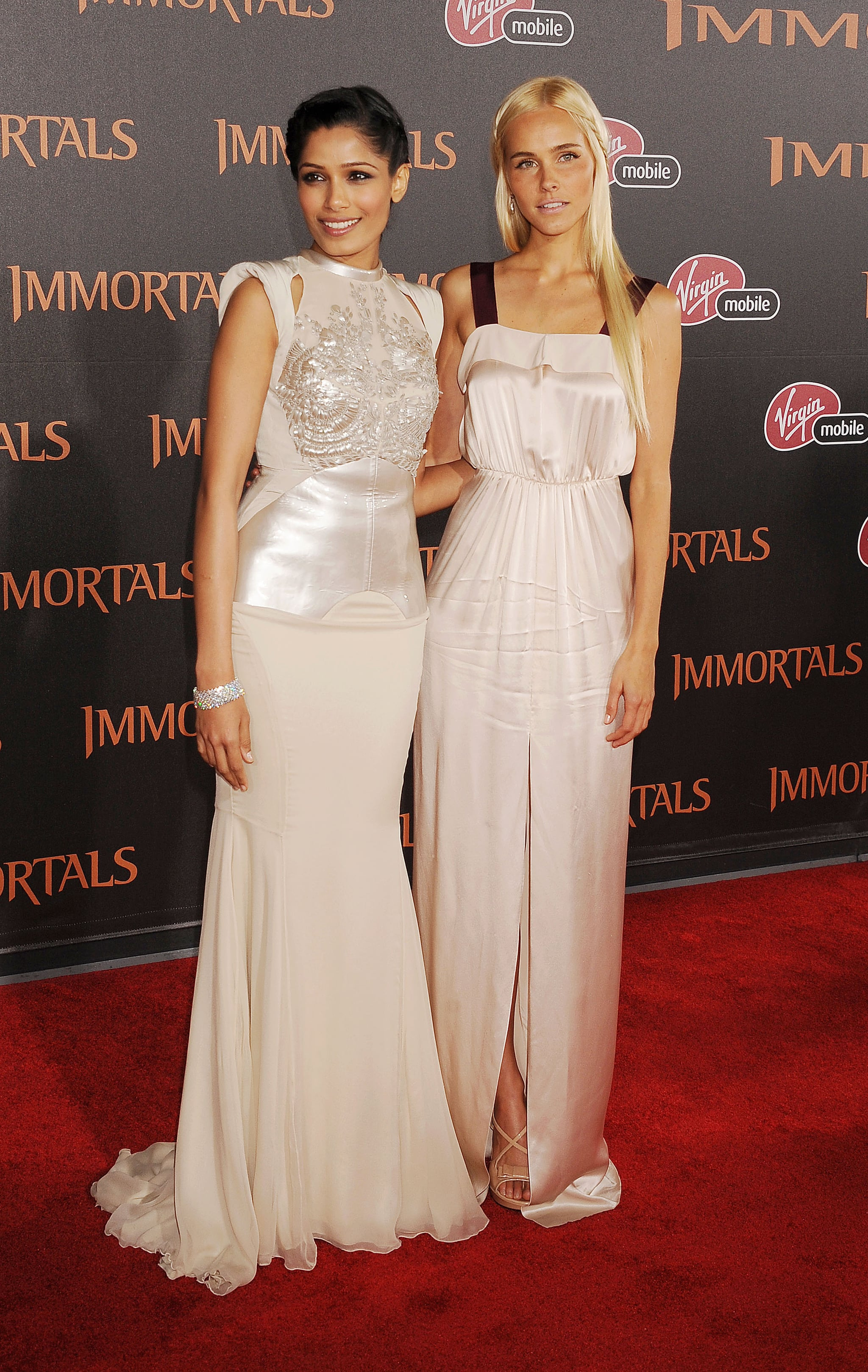 Freida Pinto and Isabel Lucas both stepped out in pale dresses.