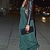 Katie Holmes perfected the art of easy elegance in a forest-green maxi and a cool-girl leather jacket on a night out in NYC.
