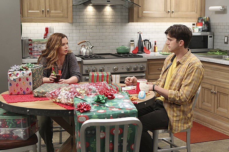 Two and a Half Men Jenny (Amber Tamblyn) and Walden (Ashton Kutcher) talk it out.