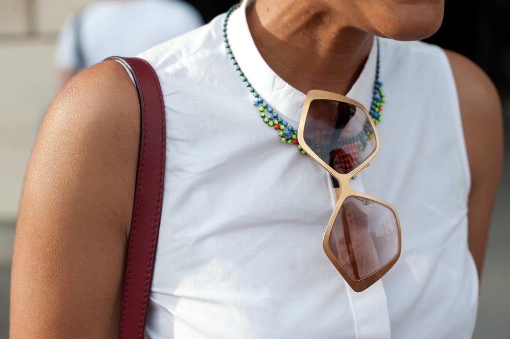 We spied these cool shades hanging off of one amazing statement necklace.