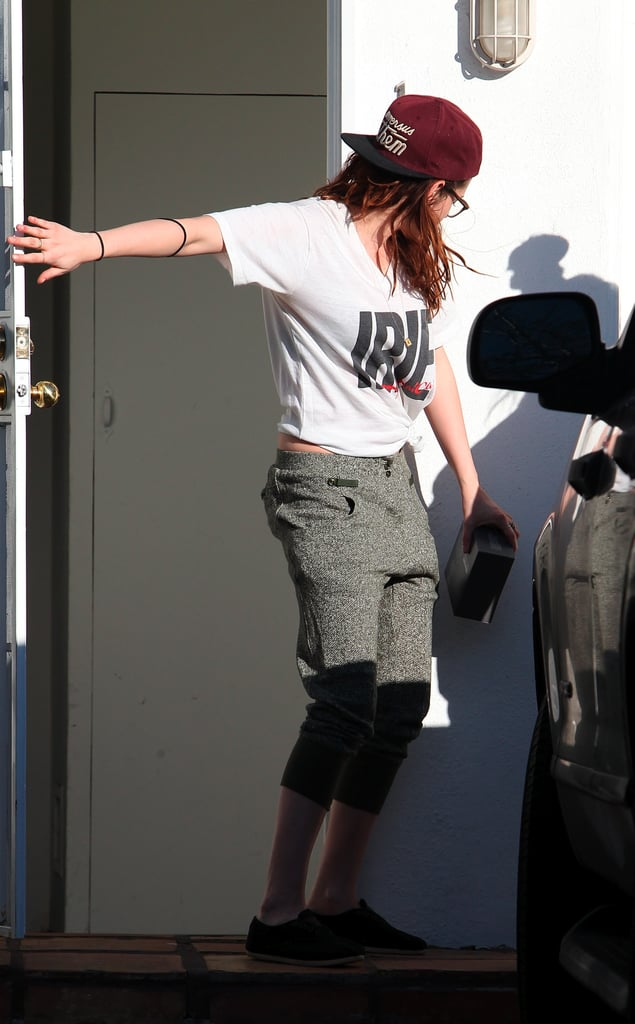 Kristen Stewart wore a baseball cap and a t-shirt.