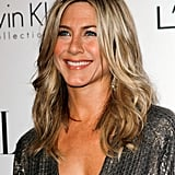 Jennifer Aniston took a spin in the red carpet at an event celebrating women in Hollywood.