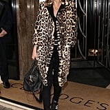 Back in September 2015, the model wrapped up in a leopard print coat.
