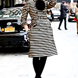Miroslava Duma was equal parts dapper and cool in a striped trench and top hat.