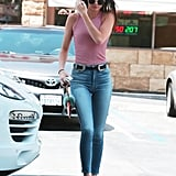 Kendall completed her striped Brandy Melville tank with 7 For All Mankind high-waisted jeans, white low-top sneakers, aviator sunglasses, and her signature B Low the Belt Bri Bri waist-cincher.