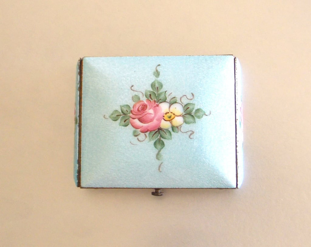 Check your makeup throughout the ceremony with a beautiful vintage compact ($40).