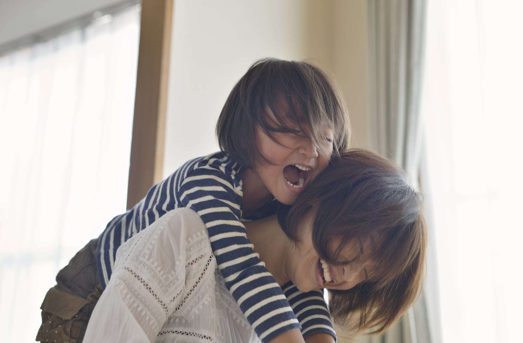 Mother giving daughter a piggyback ride,Girl of five years,Japan