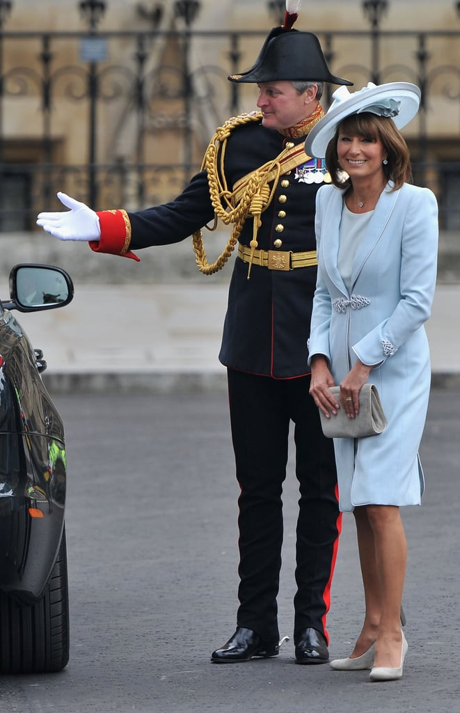 Carole Middleton and her son, James, arrived together at Westminster Abbey in London this morning for the royal wedding. The mother of the bride wore a blue wool crepe coatdress designed by Catherine Walker and a matching hat from Jane Corbett. James was dressed in tails after spending the morning having breakfast with Prince William at Clarence House. Princes William and Harry made their entrance at the abbey just a few minutes earlier and saluted the guards on their way down the red carpet. Next to arrive will be Prince Charles and Camilla Parker Bowles.