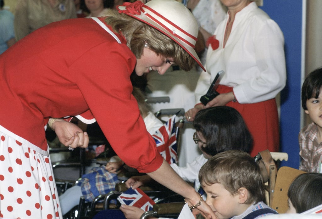 A little boy kissed her hand as she visited Canada in June 1983.
