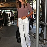 Miranda Kerr walked on the sidewalk in NYC.
