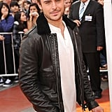 Zac Efron heating up the orange carpet in a black leather jacket.