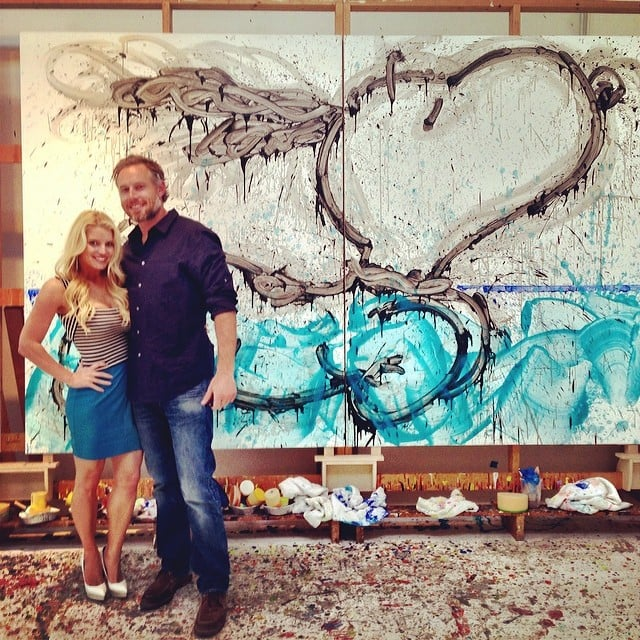 Eric and Jessica posed together in front of their new art piece on their four-year anniversary in May 2014.