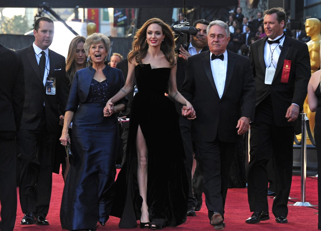 It looks like Angelina Jolie and Brad Pitt scored two extra tickets to the Academy Award celebration in LA tonight! They treated his parents, Jane and Bill, to a night on the town. Angelina, in a black velvet Atelier Versace gown held hands with Jane and Bill while the best actor nominee talked to press. Brad met up with the trio, and they made their into the Hollywood and Highland Center together. It's a big night for the Jolie-Pitt family with Angelina taking the stage to present and Brad hoping to take home his first best actor Oscar.
