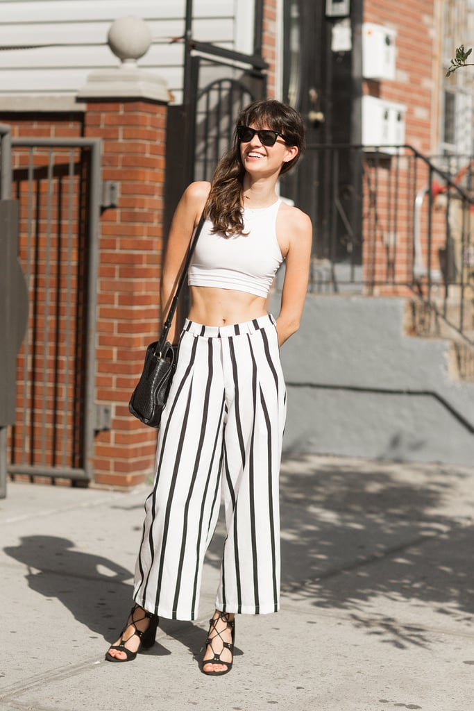 Skip the matching set and pair a crop top with high-waisted trousers for a cool spin on the hot-weather style.