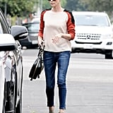 Charlize Theron sported this Line & Dot colorblock raglan top ($103) with skinny denim and taupe booties in LA.