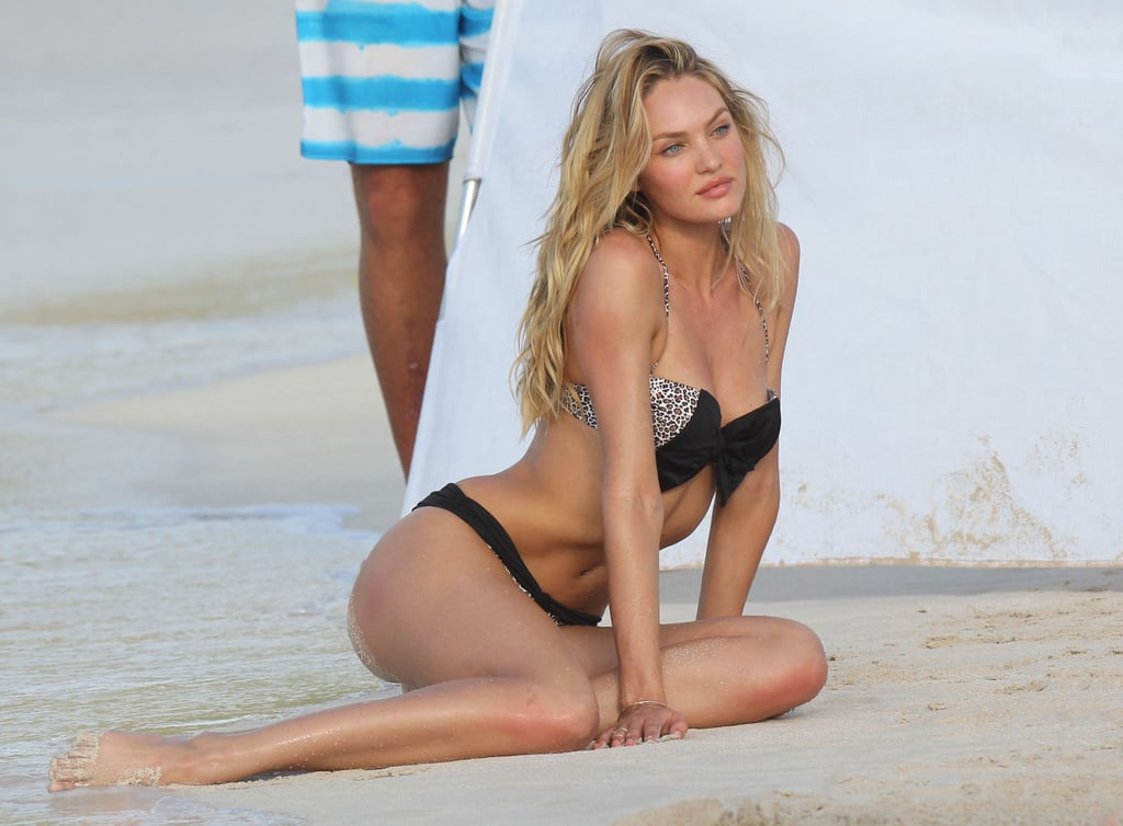 Candice Swanepoel posed on the sand.