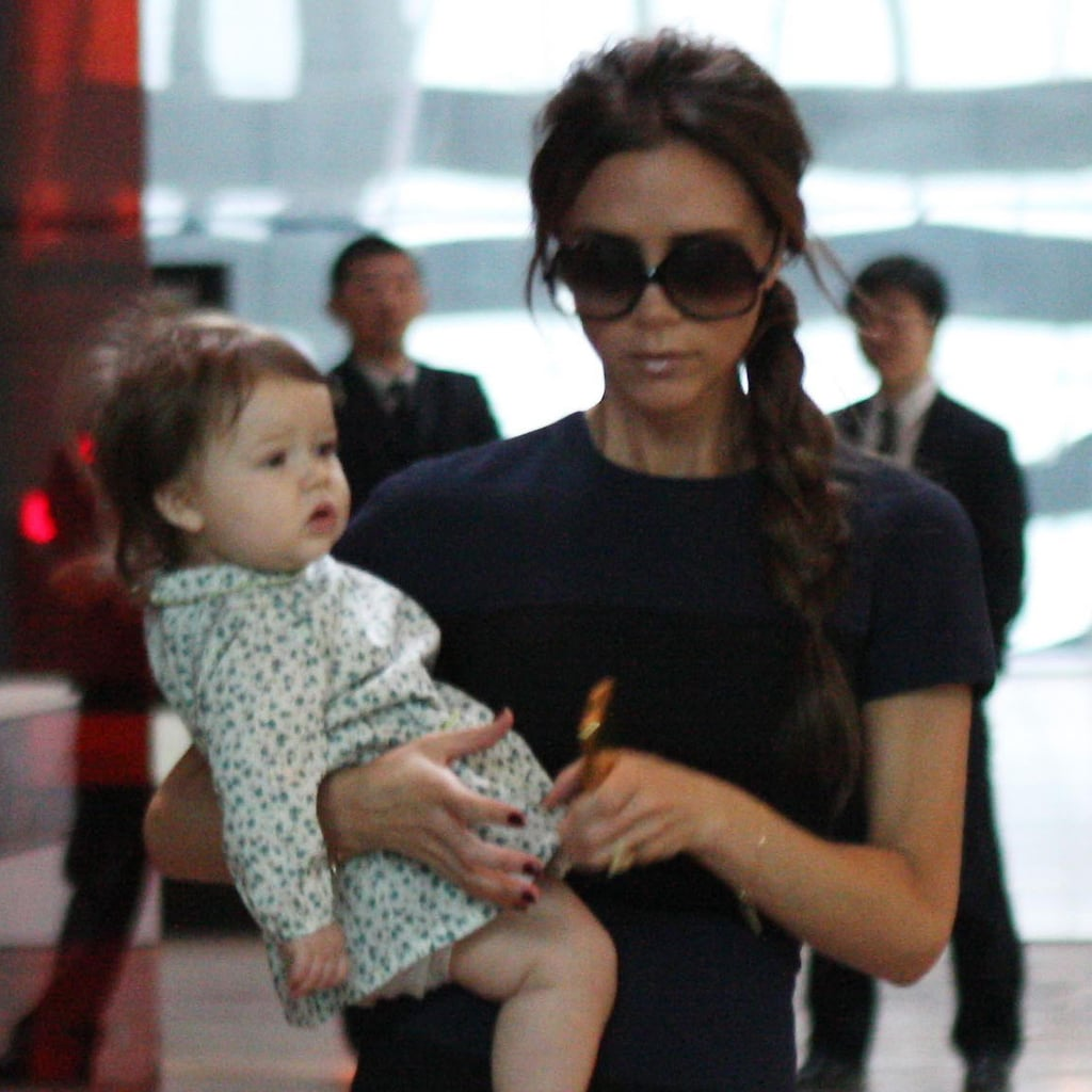Victoria and Harper Beckham coordinated in navy looks.