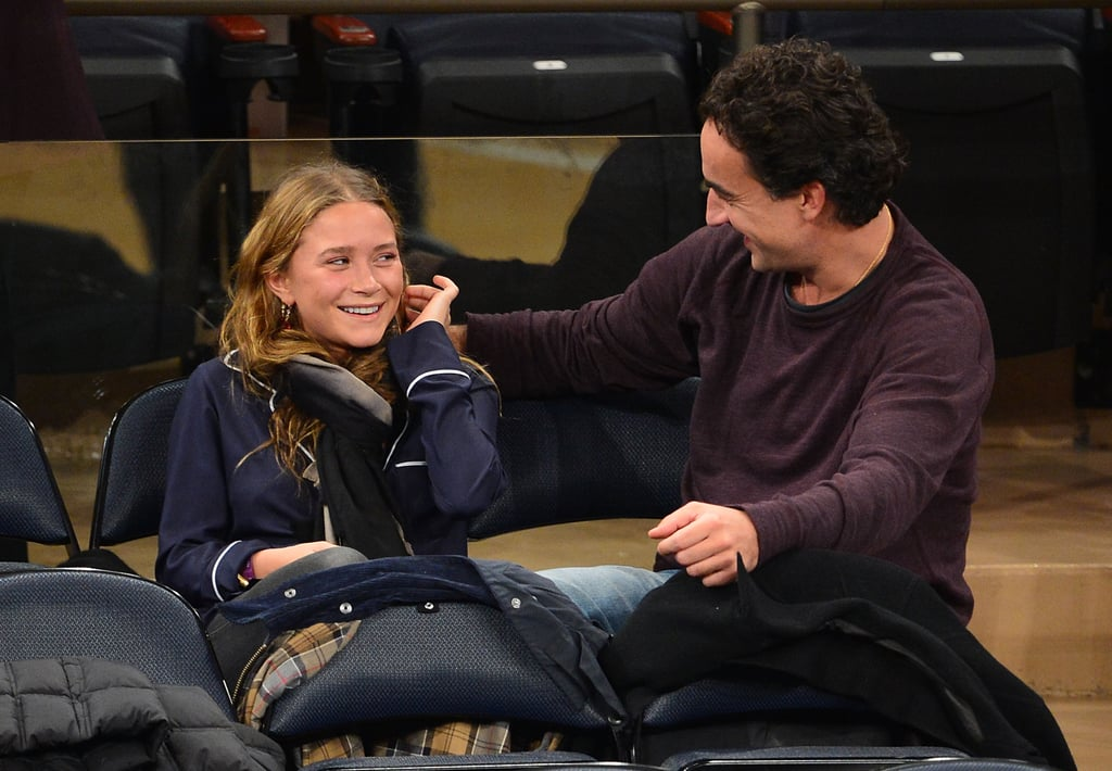 Mary-Kate Olsen and Olivier Sarkozy joked together in the stands.