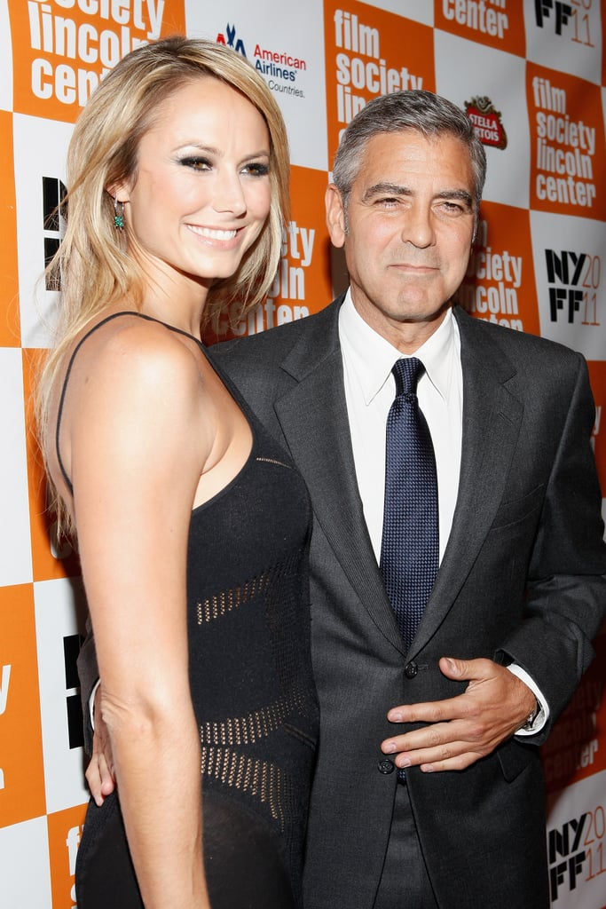George Clooney lead Stacy Keibler couldn't stop smiling in NYC.