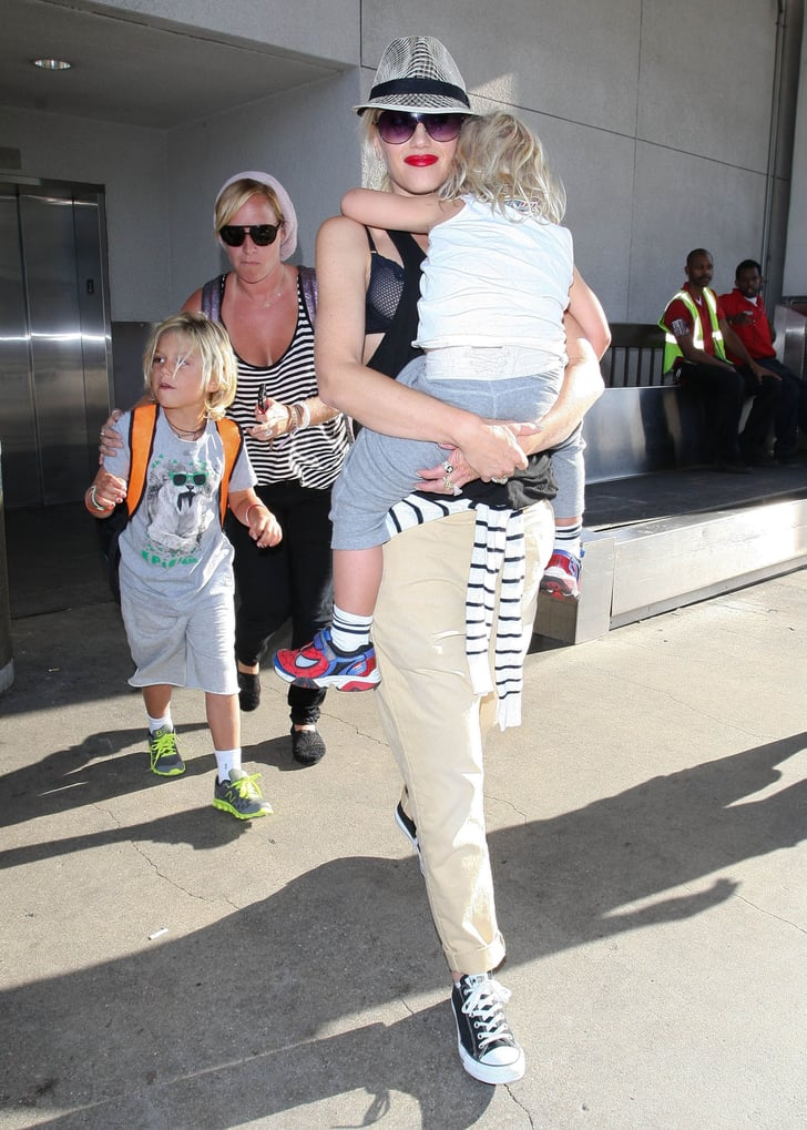 Gwen Stefani walked out of the airport carrying Zuma.