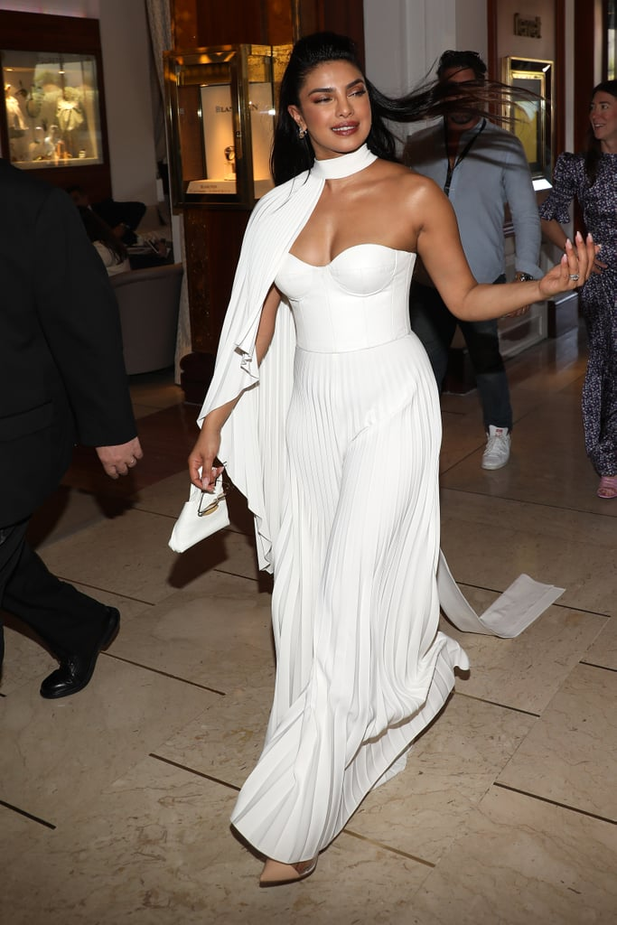 Priyanka Chopra Wearing a White Honayda Pleated Jumpsuit, Chopard Jewels, and Akris Bag at the Majestic Hotel