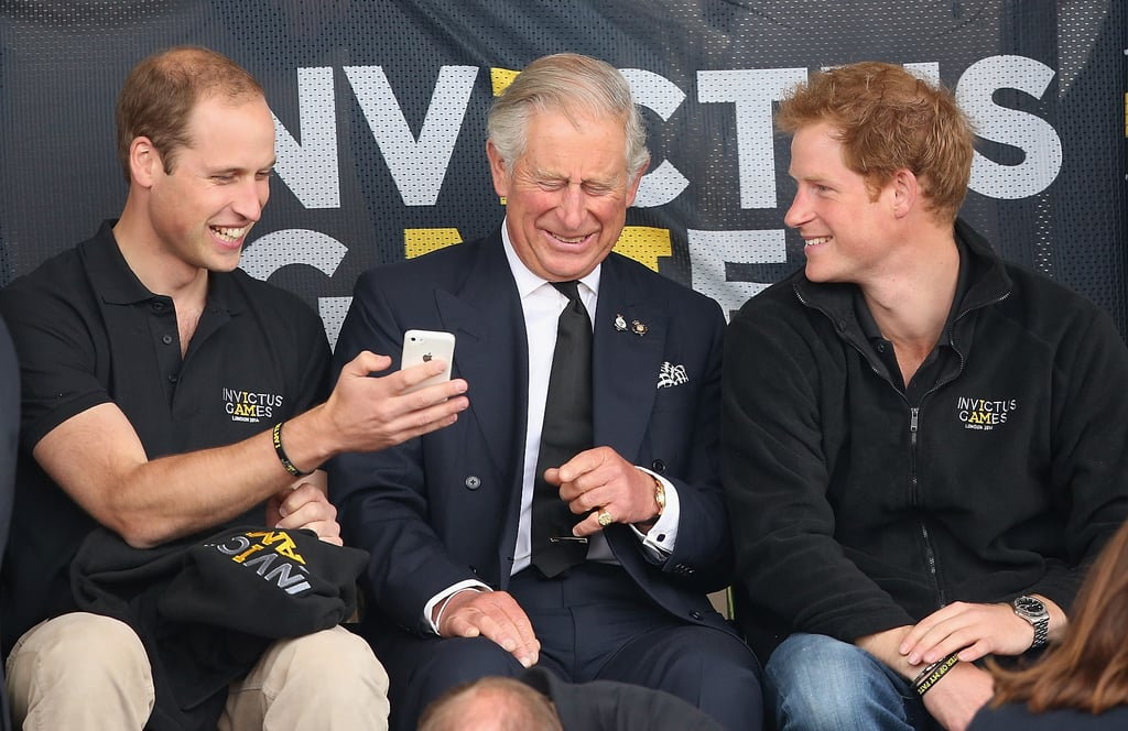 Source: Getty / Max Mumby/Indigo All eyes were on Prince Harry on Wednesday night when he launched his Invictus Games in London alongside Prince William, Prince Charles, and Camilla, Duchess of Cornwall. (Kate Middleton was slated to appear at the opening ceremony but had to pull out at the last minute due to her acute morning sickness.) The young royal, who turns 30 on Monday, was seen smiling from ear to ear as he sat with his family during the Games' opening ceremony but later got quite serious while giving his opening speech, honouring the disabled servicemen and women from around the globe who would be competing. On Thursday, on the first day of the events, Harry, Charles, and William watched a few events from the stands, and William even got a giggle out of his father by showing him something funny on his phone.  The Games are designed as a Paralympics-style event but with a focus on those who were injured during combat. Harry, who has served two tours in Afghanistan, created the Invictus Games after seeing the Warrior Games in the US during a royal visit in 2013. The plight of injured servicemen and women is a cause close to Harry's heart, as he has supported numerous charities for veterans and even hiked to the South Pole in 2013 to raise money for the Wounded Warrior Project. Watch Harry's big speech from Wednesday below, and keep reading to see more photos of Harry and the royal family at the Invictus Games.
