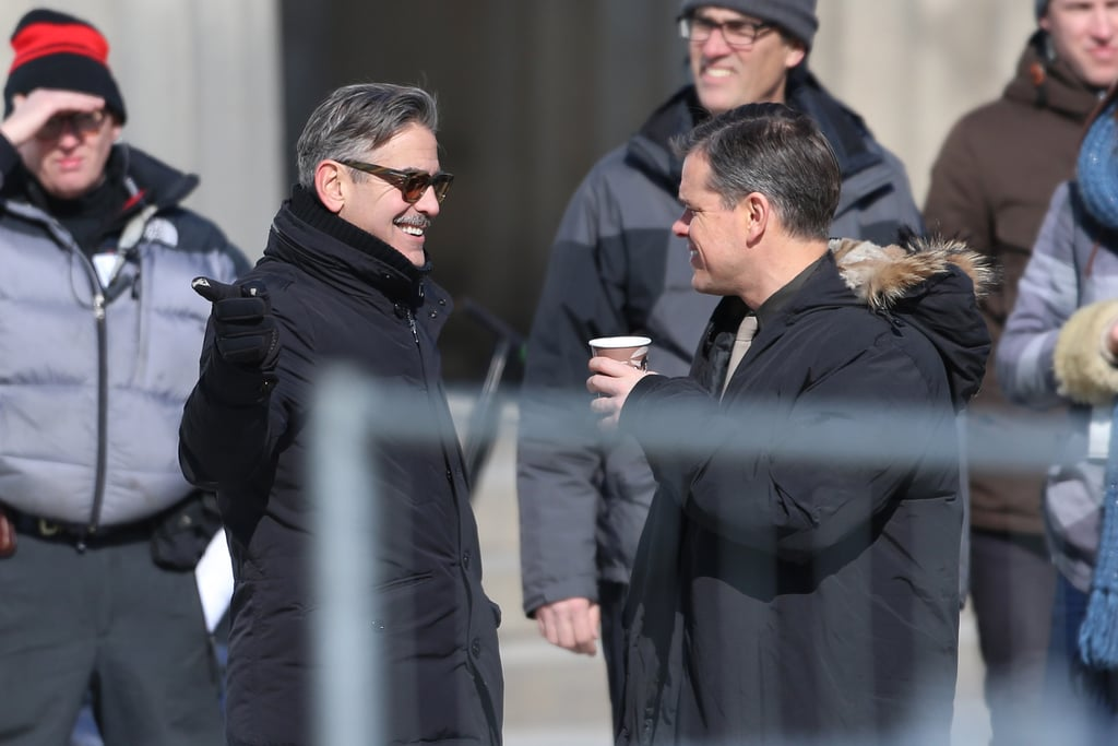 George Clooney and Matt Damon laughed while on set in Berlin together.