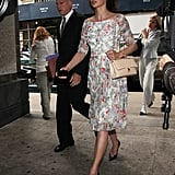 On the final day, Linda strutted in a floral Erdem dress — available to buy now! — black pointy patent pumps, oversize round shades, a gold watch, and her Chanel bag. This less-expensive floral frock is office-appropriate, too.