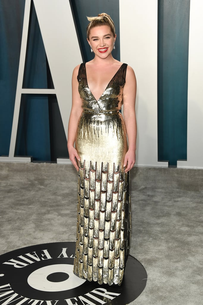 Most of Florence Pugh's recent red carpet looks have been colorful, voluminous raw silk gowns. But the Little Women actor switched it up for the Vanity Fair Oscars afterparty in a slinky Louis Vuitton dress — and wait till you see the thigh-high leg slit.   After rocking a turquoise Louis Vuitton by Nicolas Ghesquière gown for her first time at the Oscars, Florence continued to rep the iconic French house at the star-studded afterparty. Florence's custom gold sequin-covered Louis Vuitton gown featured a plunging v-neckline with an ultrasexy thigh-high slit. She paired her golden look with black Jimmy Choo Maxi 150 velvet platform sandals ($995) and diamond drop earrings. Since Florence's dress was so striking, she went for a classic makeup look — fluffy brows, dewy skin, red lips, and subtle black winged eyeliner on her upper lash line.  Ahead, see every angle of Florence's custom gold Louis Vuitton dress.       Related:                                                                                                           Don't Tell, but Florence Pugh Stood Up in the Car to Avoid Wrinkling This Dress