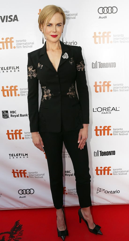 Nicole Kidman attended the Toronto premiere of The Railway Man in a slim black Altuzarra suit featuring luxurious lace insets. Black bow pumps and drop earrings proved to be the perfect accessories.