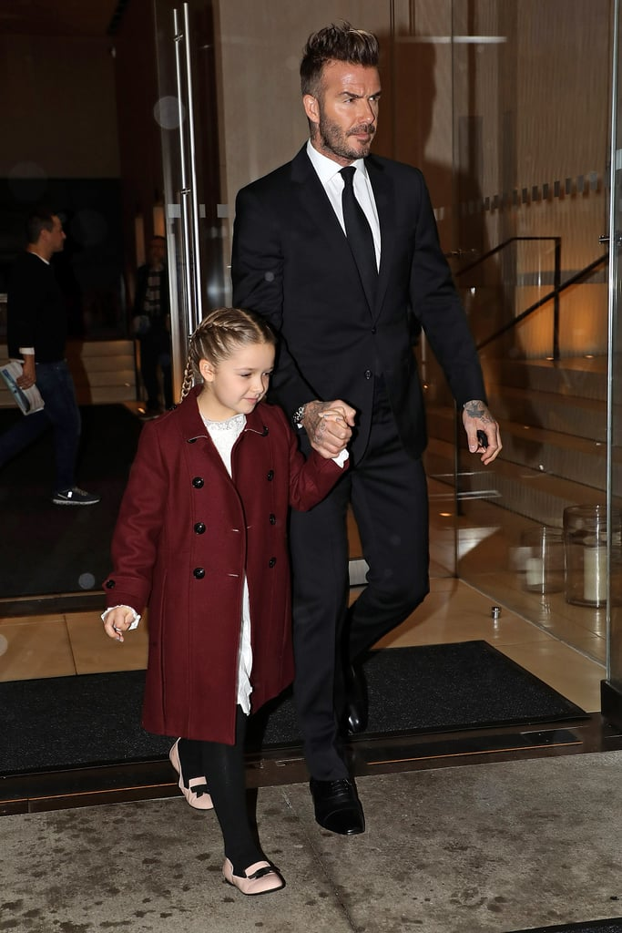 David Wore a Black Suit and Held on to Harper's Hand, Who Wore a Burgundy Coat Over a White Dress and a Pair of Black Tights