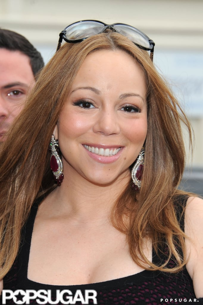 Mariah Carey had a big smile in Paris after celebrating her 4th wedding anniversary.