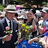 Prince Philip greeted the crowd with flowers at the Great Aussie BBQ on Oct. 29, 2011.