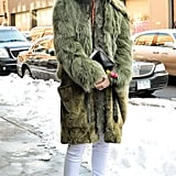 A long, furry coat — preferably in a colorful hue — and a pair of fur-lined wedge booties will keep you toasty and on point.
