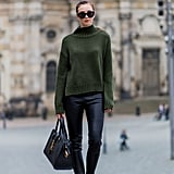 With a Khaki High-Neck Sweater and Leather Trousers