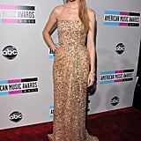 Taylor Swift opted for a floor-lenght Reem Acra gown at the 2011 American Music Awards.
