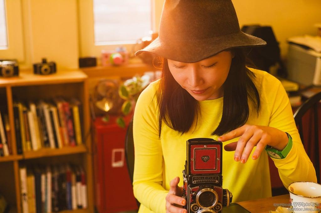 A Customer Looking at the Original Rolleiflex Camera