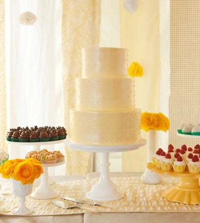 Smooth white milk glass cake stands keep the table clean with a homestyle flair. Photo by Nicole Hill Gerulat